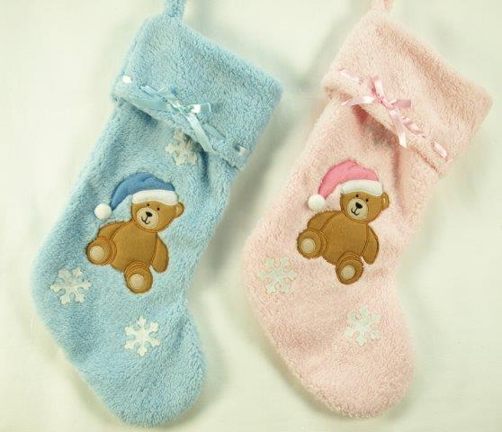pink and blue baby plush stockings with teddy bear