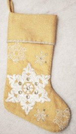 gold metallic stocking with silver snowflake design