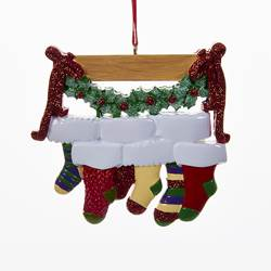 family of 6 stockings on mantle ornament