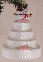 glass wedding cake with snowman topper ornament