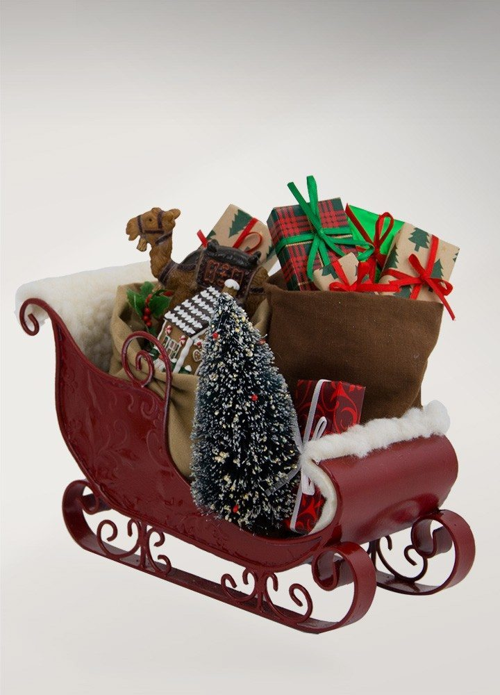 byers choice sleigh filled with toys