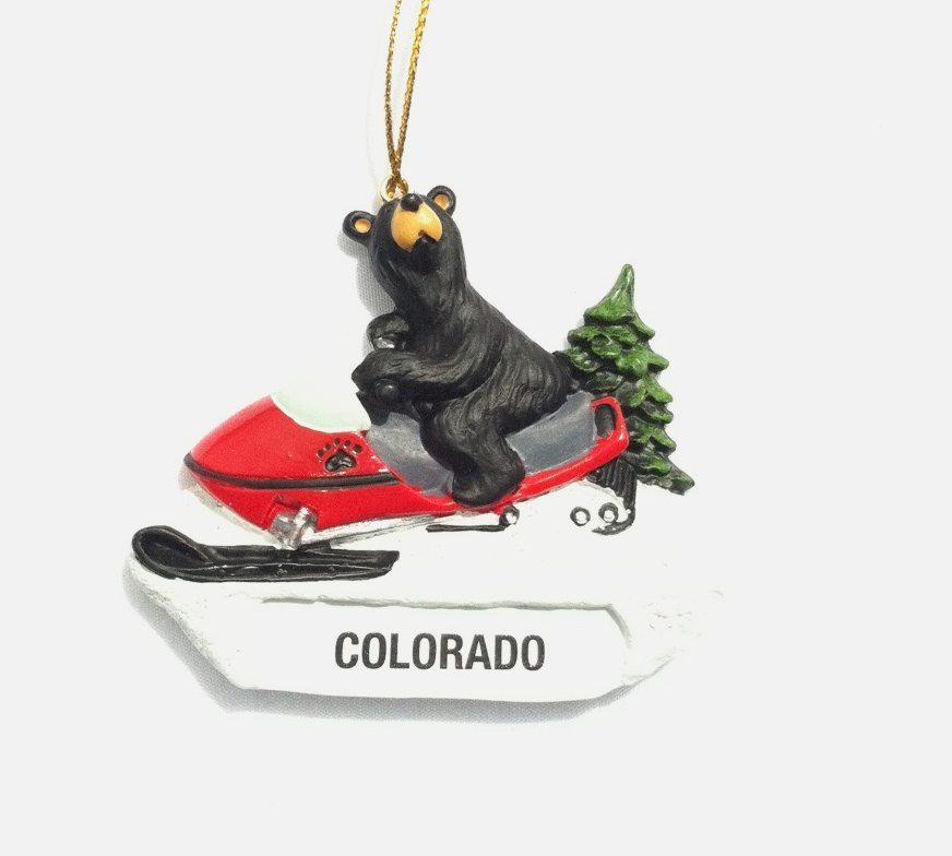 Colorado bear foot bear on snowmobile ornament christmas for Snow bear ice fishing