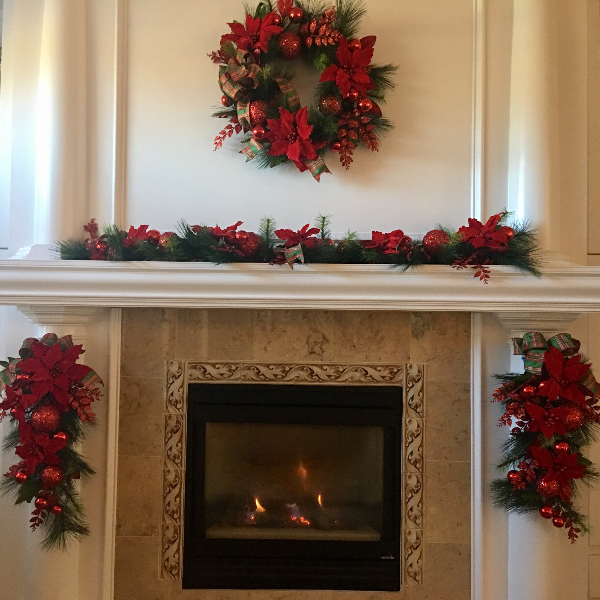 6 foot red poinsettia garland with plaid bows and glass balls