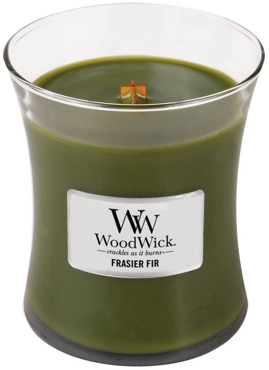 WoodWicks Fraiser Fir Scented Candle in a glass container with a crackle wich