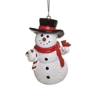 Cheerful Snowman holding a cardinal ornament