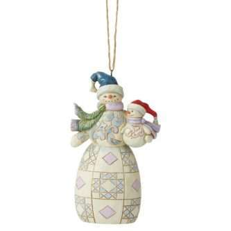 The Christmas season is the time of year to hold loved ones near. This snowman holds his child tenderly, showing the little tyke the ways of winter. The pair will peer attentively from your tree onto your family's festivities.